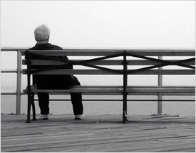Lonely man sitting on a bench